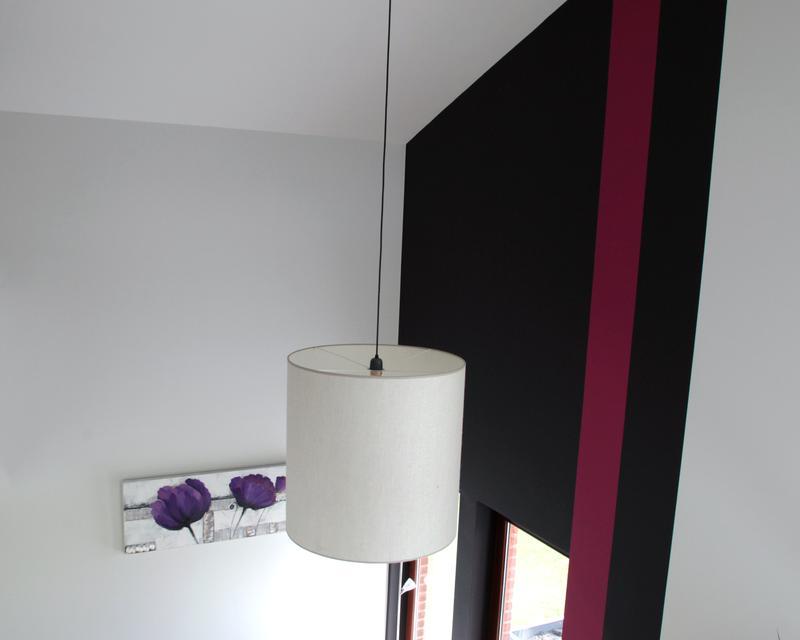 La double hauteur du salon crée une dynamique aérée